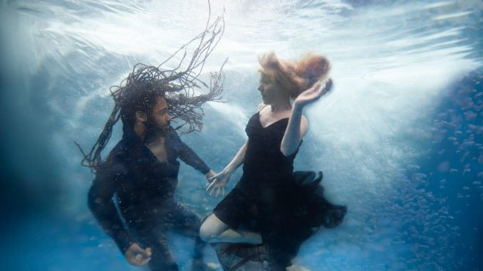 """Two lovers are separated in different dimensions in sci-fi """"Between Waves"""""""
